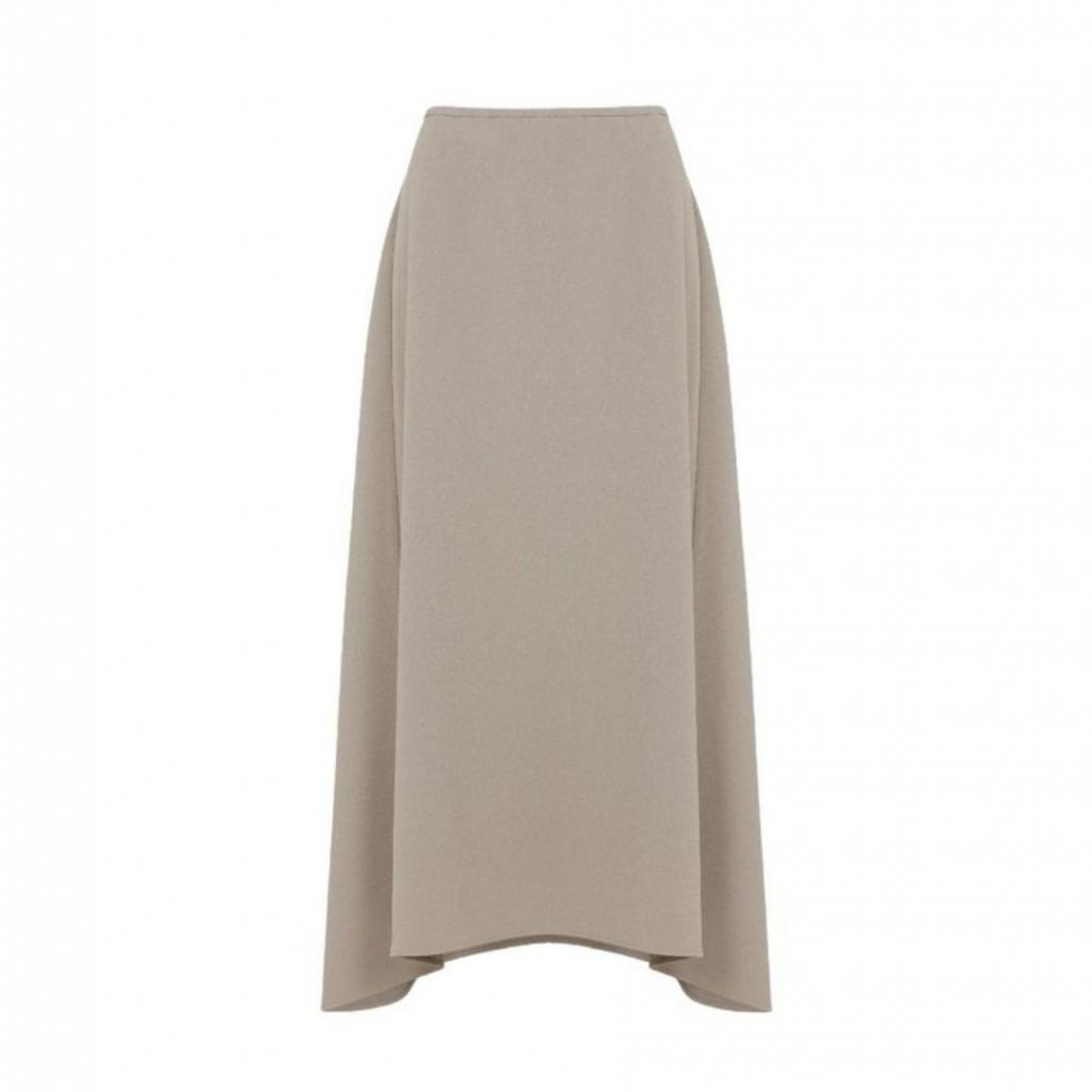 "Jupe midi, Cos, 79 €, disponible <a href=""https://www.cosstores.com/en_eur/women/womenswear/skirts/product.midi-cotton-yak-skirt-grey.0919819001.html "" target=""_blank"">ici.</a>"