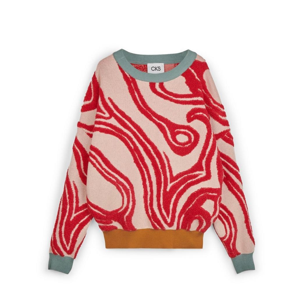 "Pull ample a motifs organiques, CKS, 99,99 €, <a href=""https://www.cks-fashion.com/fr-be/"" target=""_blank"">à shopper ici.</a>"