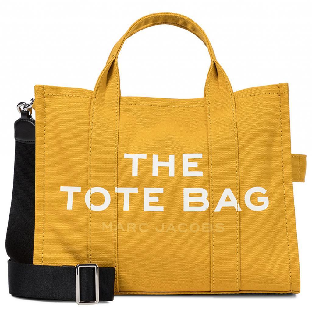 Un joli jaune pour annoncer la couleur. The Tote Bag by Marc Jacobs, 250 €